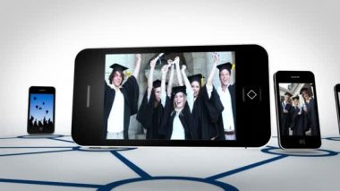 Graduate students videos on smartphone screens — Stock Video