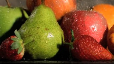 Fruits being watered in super slow motion — Stock Video