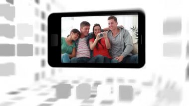 Videos of a friends in living room on a smartphone screen — Stock Video