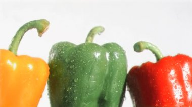 Colorful peppers in super slow motion being soaked — Stock Video