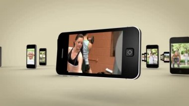 Videos of women working out on smartphone screen — Stock Video