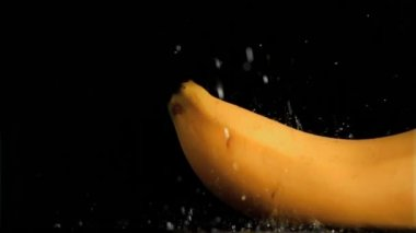 Delicious banana in super slow motion being soaked — Stock Video