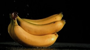Delicious bananas in super slow motion being soaked — Stock Video