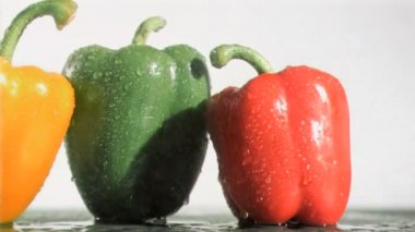 Delicious peppers in super slow motion receiving raindrops — Stock Video