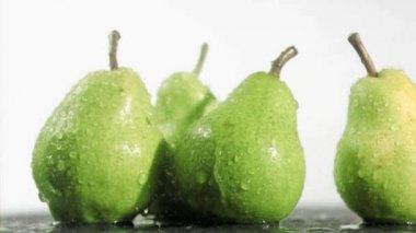 Pears in super slow motion being soaked — Stock Video