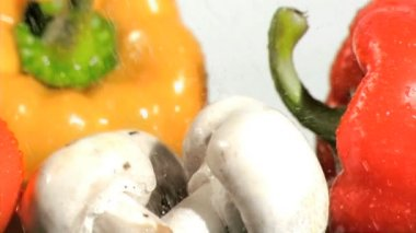 Vegetables watered in super slow motion in close-up — Stock Video