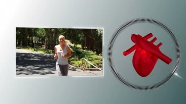 Video of a woman jogging with a heart animation — Stock Video