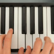 Fingers typing on piano keys — Stock Video