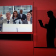 Business videos against red background - Stock Photo