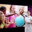 Videos of children looking a globe with an Earth image courtesy of Nasa.org — Stock Video