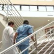 Doctor and nurse in the stairs — Stock Video