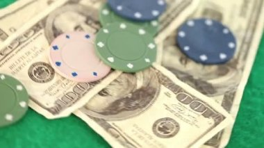 Poker coins and bills thrown on a gambling table — Stock Video