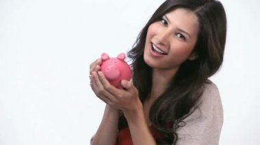Woman kissing a piggy bank — Stock Video