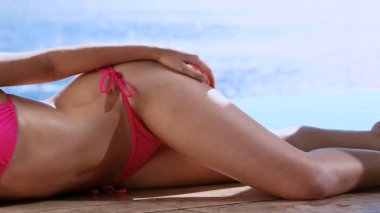Woman lying on side while wearing a beachwear — Stock Video