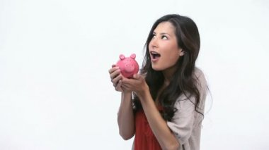 Happy woman kissing a piggy bank — Stock Video