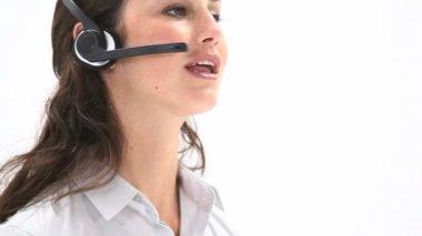 Elegant woman talking into a headset — Stock Video