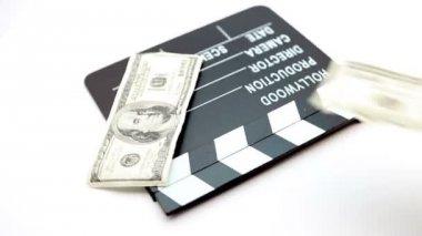 Dollar bills placed on a cinema clap — Stock Video