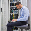 Man trying to find a solution for servers — Stock Photo #23045144