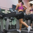 Stock Photo: Two women exercising on treadmills