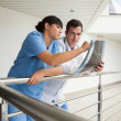 Nurse asking the doctor about x-ray — Stock Photo