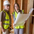 Smiling architects holding blueprints — Stock Photo #23045210