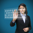Businesswoman typing on projected digital keyboard — Stock Photo