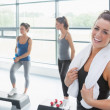 Happy womtaking break at aerobics class — Stock Photo #23045422