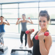 Three happy women doing aerobics — Stock Photo
