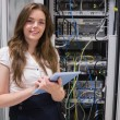 Stock Photo: Smiling womusing tablet pc to work on servers