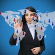 Womtouching blue world map interface — Stock Photo #23045682