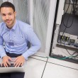 Stock Photo: Msmiling while doing server maintenance