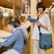 Woman with tablet pc in library — 图库照片