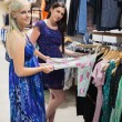 Woman and friend shopping - Stock Photo