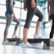 Three women in aerobics class - Stock Photo