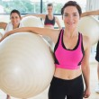 Stock Photo: Happy group wtih exercise balls