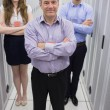 Smiling technicians standing in data center — Stock Photo