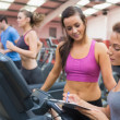 Female gym instructor and woman - Stock Photo
