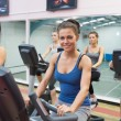 Woman smiling at spinning class — Stock Photo #23046622