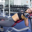 Woman training with weights — Stock Photo