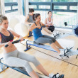 Focused sitting at the row machine — Stock Photo