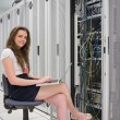 Happy woman with laptop working with servers — Stock Photo