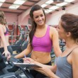 Women smiling in gym — Stok fotoğraf