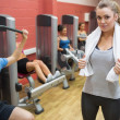 Stock Photo: Female trainer teaching her fitness class