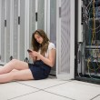 Woman texting next to the servers — Stock Photo