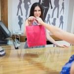 Woman is buying something — Stock Photo