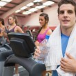 Man smiling in gym - Stock Photo