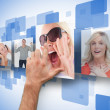 Male hand selecting one of four photos on digital wall — Stock Photo