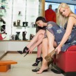 Women trying on shoes — Stock Photo