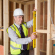 Architect measuring the door — Stock Photo