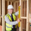 Architect measuring the door — Stockfoto